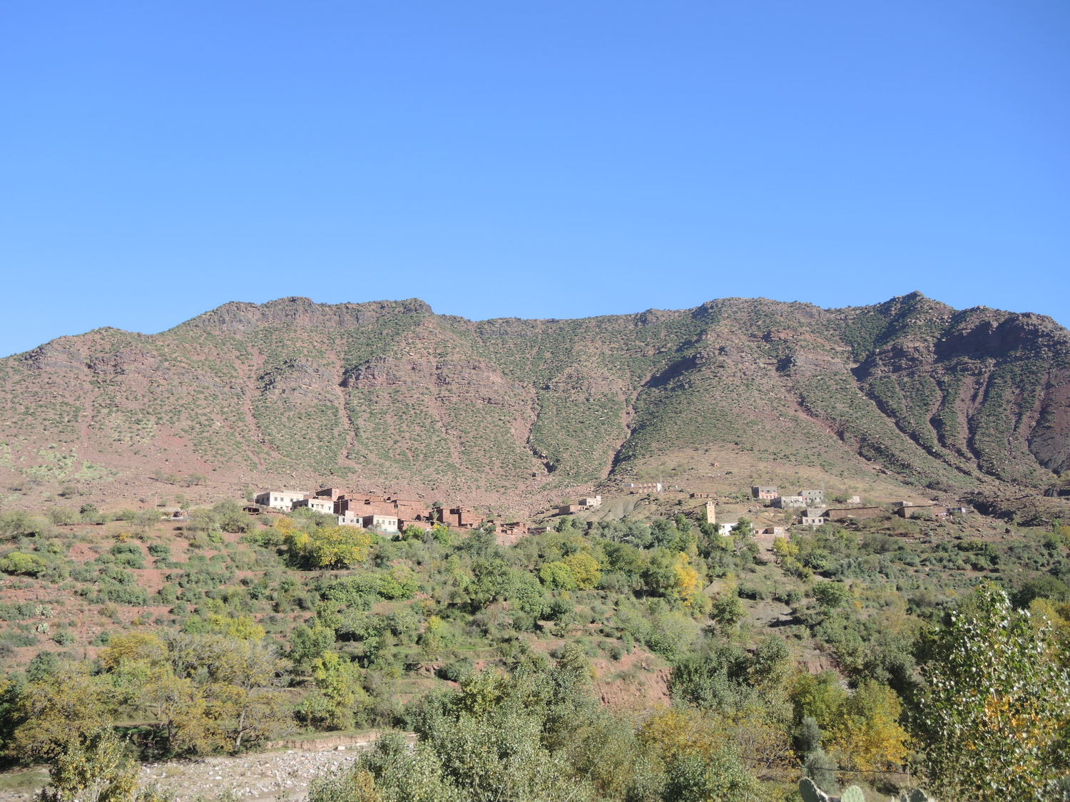 Deeper valleys of the Atlas Mountains near the rivers are green and habituaed